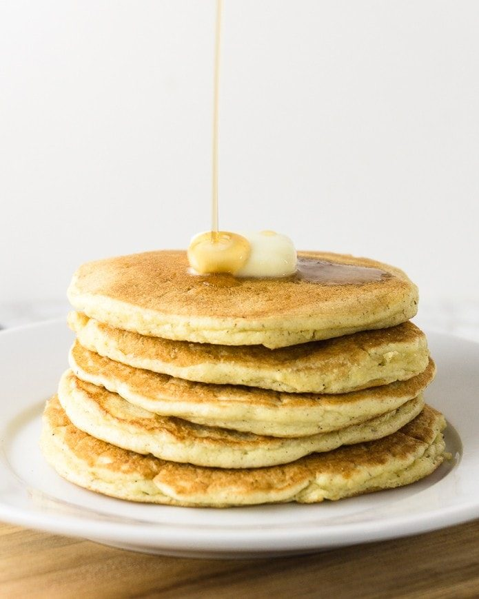 keto pancakes with keto syrup being poured on top