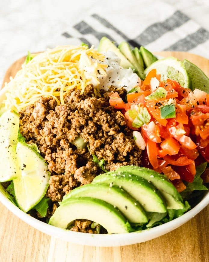 easy keto taco salad recipe made with ground beef and shredded cheese