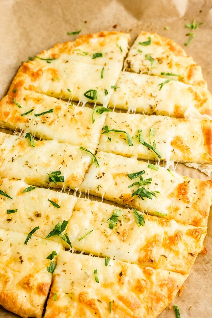 keto cheesy garlic breadsticks topped with herbs