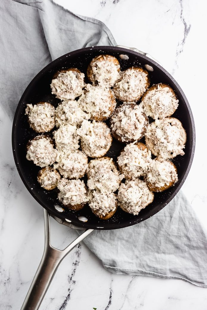 keto stuffed mushrooms topped with Parmesan cheese