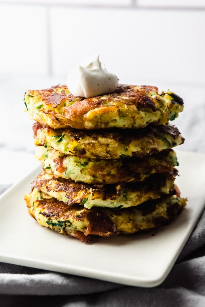 stack of crispy low carb zucchini fritters with bacon