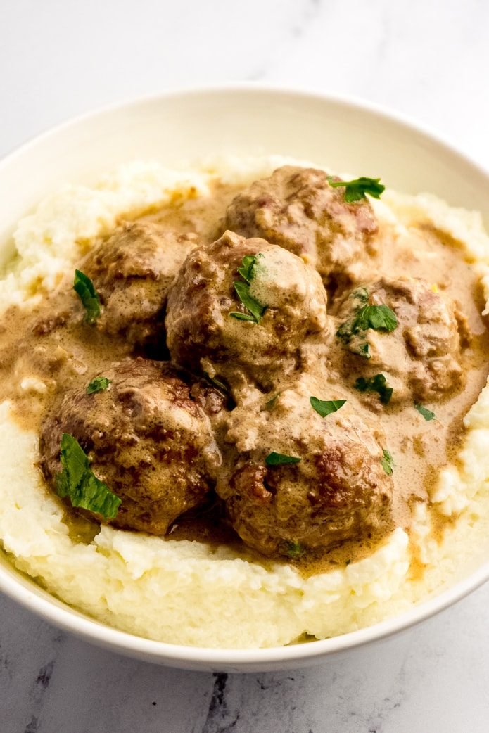 keto swedish meatballs on creamy mashed cauliflower