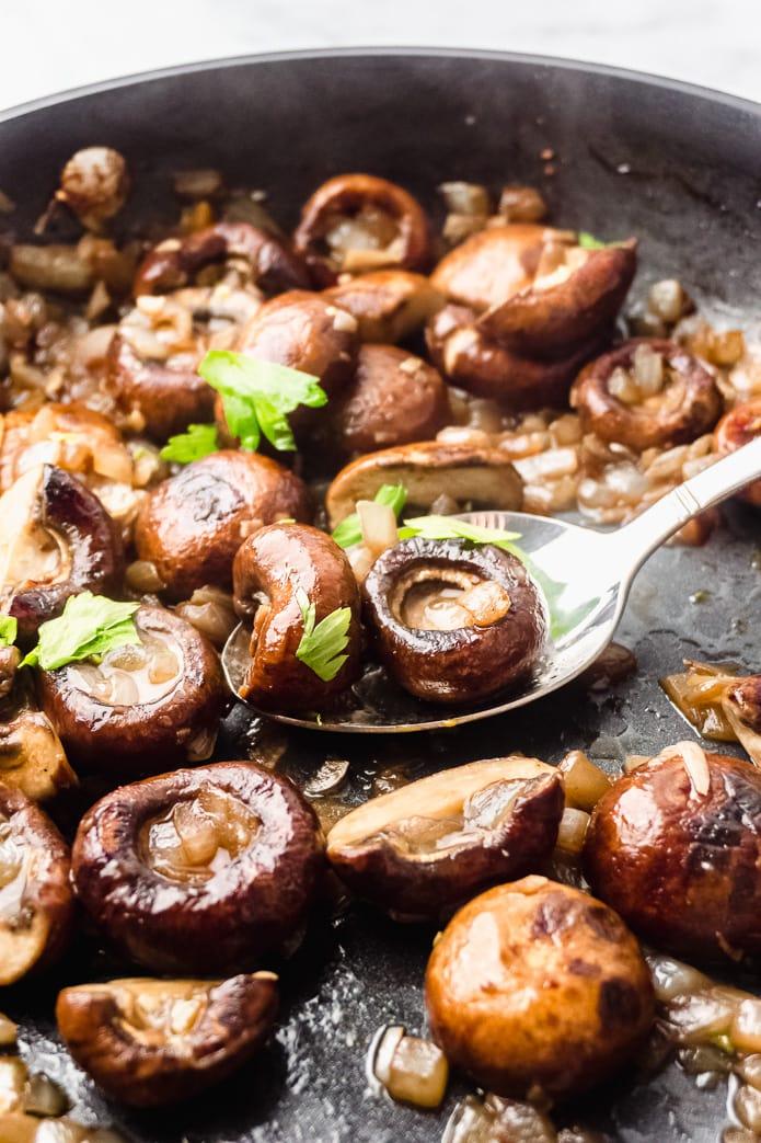 mushrooms in garlic butter sauce in a pan
