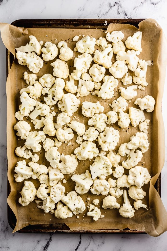raw cauliflower florets on a sheet pan