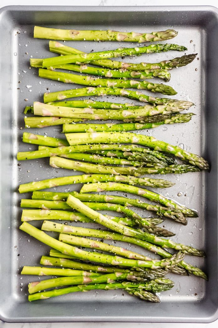 healthy keto oven roasted asparagus on a baking pan