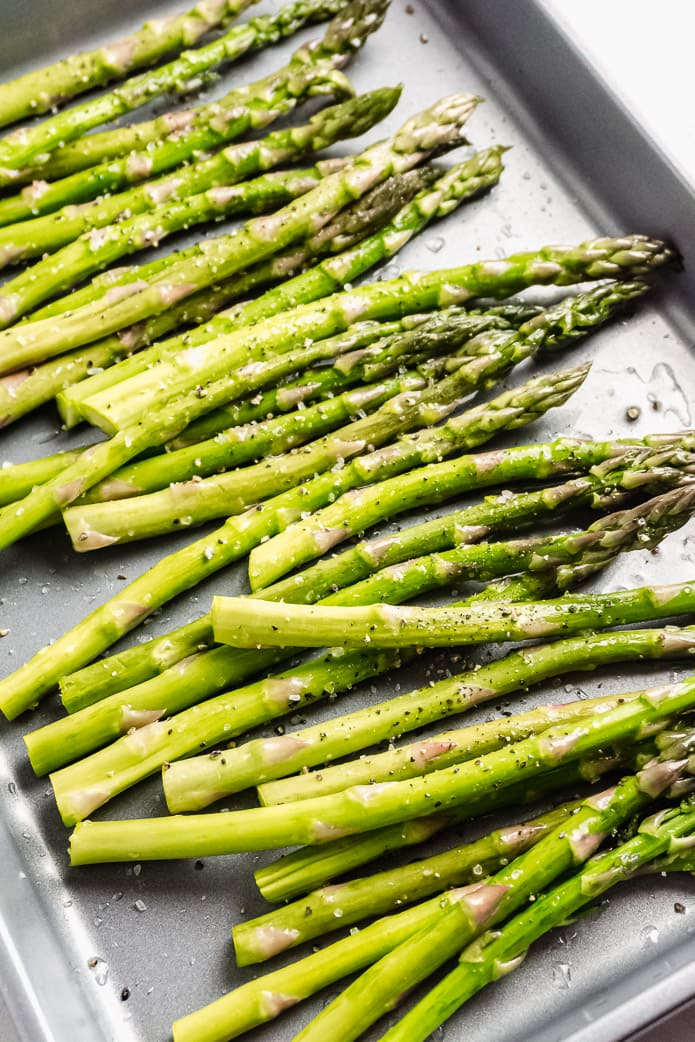 asparagus stalks seasoned with olive oil, salt and pepper